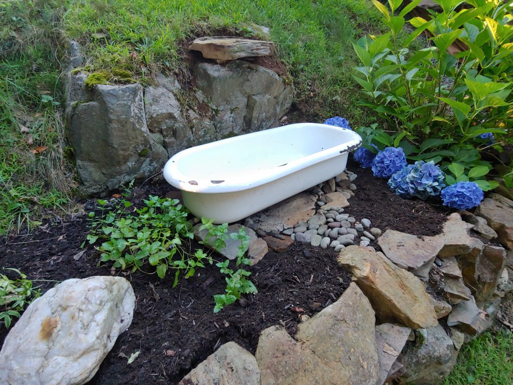DIY Backyard Water Fountain using an Antique Baby Bathtub or any water-tight container as a basin - Follow my easy tutorial to create a serene and peaceful bird bath water feature on your property. Perfect for a mediation sanctuary. Attract butterfies and wildlife to your backyard.